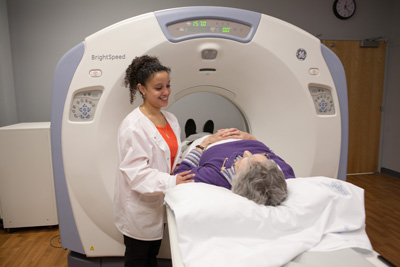 Woman going into CT scan